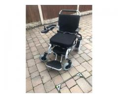 Freedom motorised wheel chair with additional battery.